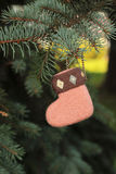 Wool shoe toy. Wool boots toy on  needle tree Stock Photos