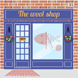 Wool shop building. Facade of red brick. Knitting sign sticker on window. Vector illustration EPS10 Royalty Free Stock Photography