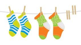 Wool Socks. Handmade wool socks hanging on a clothesline Stock Images