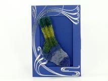 Wool socks on blue card, handmade knitted sock Stock Photo