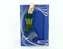 Wool socks on blue card, handmade knitted sock Stock Photography