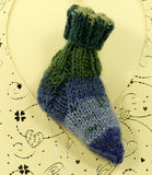 Wool socks on blue card, handmade knitted sock Royalty Free Stock Images