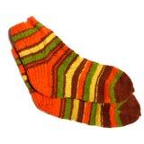 Wool socks. Hand knitted warm wool socks on a white background Stock Photo