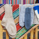 Wool socks and mittens hanging on rustic cloth Royalty Free Stock Photography