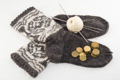 Wool socks and money. How much cost of preparing for winter - knitting wool socks Stock Images