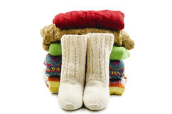 Wool socks and stack of various sweaters. Winter style Stock Image