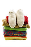 Wool socks and stack of various sweaters. Winter style Royalty Free Stock Image