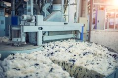Wool spinning and mixing in textile mills royalty free stock photography