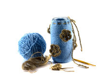 Wool and sticks in a vase and a hook Royalty Free Stock Image