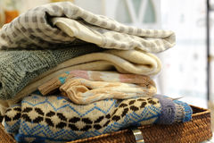 Wool sweater. Colorful wool sweaters on the clothes basket stock photo
