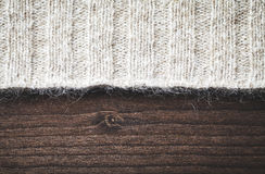 Wool sweater on wood Stock Images