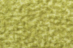 Wool texture background, macro of green woolen fabric, hairy flu Royalty Free Stock Images