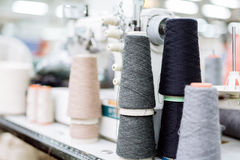 Wool and thread spools on desk Royalty Free Stock Photos