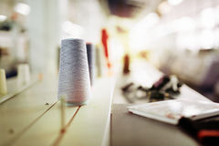 Wool and thread spools on desk Royalty Free Stock Images