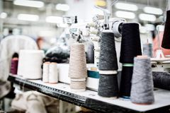 Wool and thread spools on desk Royalty Free Stock Photography