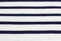 Wool white pullover with black stripes, texture background. Wool white pullover with black stripes, texture background Stock Images