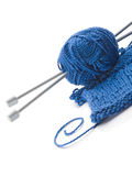 Wool and wooden needles. Over white background stock image