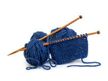 Wool yarn blue colors and wooden needles Stock Image