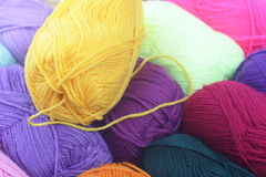 Wool yarn. In blue, yellow, pink Royalty Free Stock Image