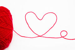 Wool yarn with heart symbol Royalty Free Stock Image