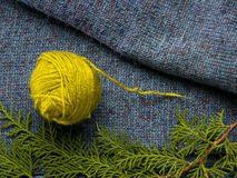 Wool yarn on a jumper with needle Royalty Free Stock Photo