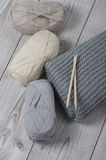Wool yarn and knitted blanket Royalty Free Stock Photos