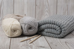 Wool yarn and knitted blanket Stock Photo