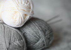 Wool yarn and needles for knitting Stock Images