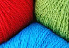 Wool yarn in red, blue and green Stock Photo