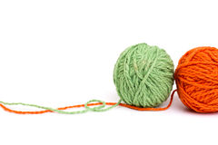 Wool yarns. Ball of green and orange wool yarns - isolated Royalty Free Stock Photos