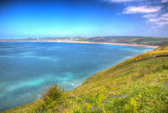 Woolacombe coast Devon England UK in summer with blue sky in hdr Royalty Free Stock Image