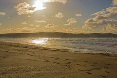Woolacombe Sand near Barnstaple, Devon, England. Sandy beach at Woolacombe Sand near Barnstaple in North Devon, England. Contre-jour photograph against the sun Stock Photos
