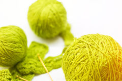 Woolen ball made of thread and knitting needles Stock Photo