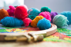 Woolen balls of yarn, tambour and embroidery. Royalty Free Stock Photography