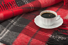 A woolen blanket and a cup of coffee Stock Photography