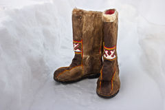Woolen boots in the snow. Old russian boots -  pima Stock Photos