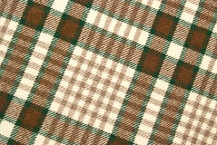Woolen and brown checked plaid Royalty Free Stock Photo