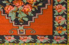 Woolen carpet with bright floral pattern Royalty Free Stock Image
