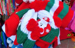Woolen Christmas hats for sale at opened Christmas market in Cuenca, Ecuador. stock photography
