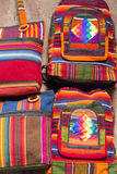 Woolen colored bag at the Andean market of Cusco, Peru. Handmade colored woolen bag for sale at the tourist craft market in Cusco. Peru Royalty Free Stock Photography