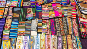 Woolen colored fabrics at the Andean market of Cusco, Peru. Handmade colored woolen fabrics for sale at the tourist craft market in Cusco. Peru Royalty Free Stock Images
