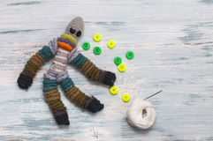 Woolen doll lying on the table Stock Photo