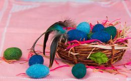 Woolen eggs in the basket Royalty Free Stock Photos