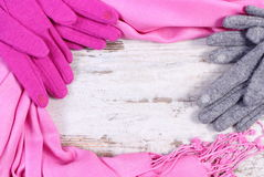 Woolen gloves and shawl with copy space for text, old rustic wooden background Stock Photos