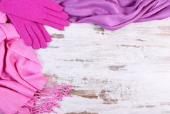 Woolen gloves and shawl with copy space for text, old rustic wooden background Royalty Free Stock Image