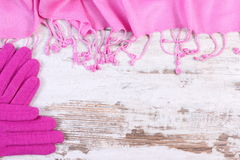 Woolen gloves and shawl with copy space for text, old rustic wooden background Stock Image