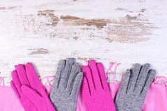 Woolen gloves and shawl with copy space for text, old rustic wooden background Royalty Free Stock Photo