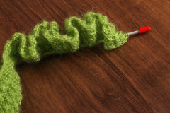 Woolen Green  on the Wood in winter Royalty Free Stock Images
