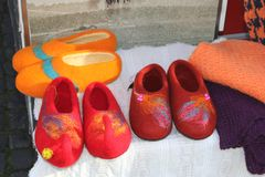 Woolen hand made felt babouches and shawls at the market in Vilnius, Lithuania. Woolen handicrafted and felted capet slippers (babouches) and woolen shawls are Stock Image
