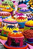 Woolen hats at the market of Otavalo Stock Photos